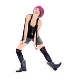 Funny young woman in military boots and pink hat. On white background Royalty Free Stock Image