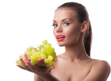 Funny young woman offer green grapes Stock Photography
