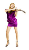 Funny young woman posing with guitar. Funny young woman playing guitar in a violin manner Royalty Free Stock Photo