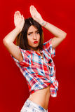 Funny young woman posing with hands over her head Royalty Free Stock Photos