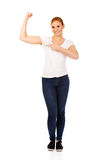 Funny young woman showing her muscles Royalty Free Stock Photography
