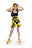 Funny young woman in studio with yellow balls. Over white royalty free stock photos
