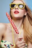 Funny young Woman in Sunglasses, Lollipop Royalty Free Stock Photos