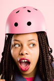 Funny woman wearing Cycling Helmet portrait pink background real Royalty Free Stock Photography