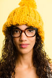 Serious woman portrait real people high definition yellow backgr Stock Image