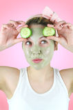 Funny young woman wearing green facial mask. Royalty Free Stock Image