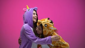 Funny young women wearing unicorn and giraffe pajamas, laughing, entertainment. Stock footage stock video footage