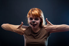 Funny zombie girl showing thumbs up Royalty Free Stock Photo