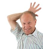 Funnyman. Aged man fooling about. White background Royalty Free Stock Photo