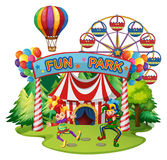 Funpark scene with clowns and rides Stock Photos