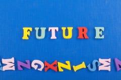 FUNURE-ord på blå bakgrund som komponeras från träbokstäver för färgrikt abc-alfabetkvarter, kopieringsutrymme för annonstext Royaltyfria Foton