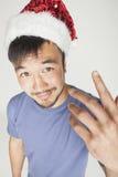 Funy εξωτικός ασιατικός Άγιος Βασίλης στο νέο κόκκινο ετών στοκ φωτογραφία