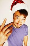 Funy εξωτικός ασιατικός Άγιος Βασίλης στο νέο χαμόγελο καπέλων ετών κόκκινο στοκ εικόνες