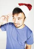 Funy εξωτικός ασιατικός Άγιος Βασίλης στο νέο χαμόγελο καπέλων ετών κόκκινο στοκ φωτογραφίες