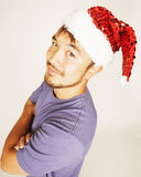 Funy exotical asian Santa claus in new years red hat smiling Stock Image