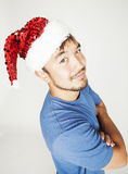 Funy exotical asian Santa claus in new years red hat smiling Royalty Free Stock Images