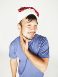 Funy exotical asian Santa claus in new years red hat smiling Royalty Free Stock Photo