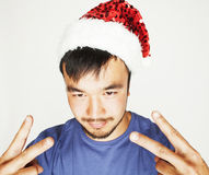 Funy exotical asian Santa claus in new years red hat smiling Stock Photography