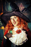Funy witch. Portrait of a pretty funny witch in the wizarding lair. Fairytales. Halloween Royalty Free Stock Photo