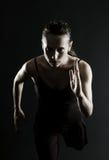 Funzionamento attraente dell'atleta Fotografia Stock