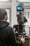 Funzionamento del cineoperatore Fotografia Stock