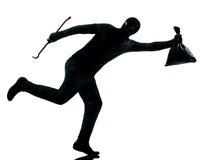 Funzionamento del criminale del ladro dell'uomo Immagine Stock