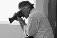 Funzionamento del fotografo Fotografia Stock