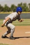 Funzionamento del giocatore di baseball Immagini Stock