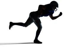 Funzionamento del giocatore di football americano della siluetta immagine stock