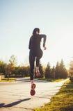 Funzionamento dell'atleta del corridore nel parco Fotografia Stock