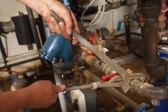 Funzionamento dell'idraulico Fotografia Stock Libera da Diritti