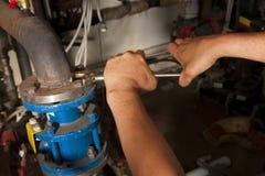 Funzionamento dell'idraulico Fotografia Stock