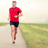 Funzionamento dell'uomo e stile di vita sano di addestramento Immagini Stock Libere da Diritti