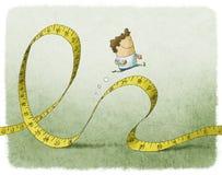 Funzionamento dell'uomo sulla misura di nastro Immagine Stock