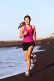 Funzionamento della donna di sport di forma fisica Immagini Stock