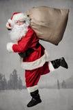 Funzionamento di Santa Claus Fotografie Stock Libere da Diritti