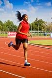 Funzionamento femminile dell'atleta Fotografia Stock