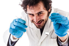 Funzionamento sorridente del dentista Fotografia Stock Libera da Diritti