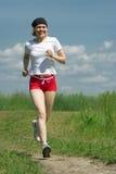 Funzionamento sportivo della donna Immagini Stock Libere da Diritti