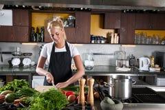 Funzionando nella cucina Fotografia Stock Libera da Diritti