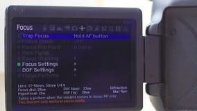 Funzioni della lanterna magica dei firmware sulla macchina fotografica Canon video d archivio