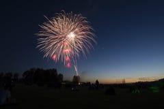 Fuochi d'artificio al tramonto Immagini Stock