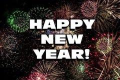 Fuochi d'artificio di nuovo anno felice fotografie stock