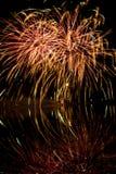 Fuochi d'artificio rossi ed arancio Fotografia Stock