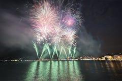 Fuochi d'artificio sul lago lugano fotografia stock