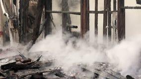 fuoco in casa di legno stock footage