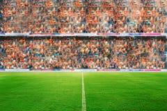 Fuoco confuso e molle del campo di calcio dell'arena e dello stadio di football americano immagini stock