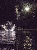 Fuoco d'artificio dal mare in Marina di Massa Fotografia Stock