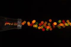 Fuoco d'artificio del bokeh della bottiglia di vetro Immagine Stock