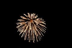 Fuoco d'artificio luminoso dell'oro fotografia stock